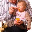 Royalty-Free Stock Photo: Man is feeding his baby