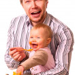 Man is feeding his baby — Stock Photo