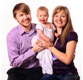 Happy family with baby — Stock Photo