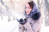 Woman is blowing snow — Stock Photo