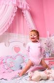 Baby in bedroom — Stock Photo