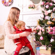 Decorating christmas tree — Stock Photo #18666727