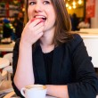 Woman is eating dessert — Stock Photo #18666731