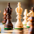Wooden chess pieces — Stock Photo