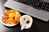 Laptop and cup — Stock Photo