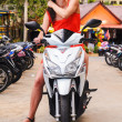 Woman on white scooter — Stock Photo #21705695
