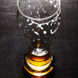 Drained glass of lager beer on table — Stock Photo