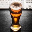Glass of lager beer on table — Stock Photo #22122835