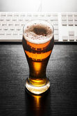Glass of lager beer on table — Stock Photo