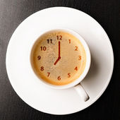 Clock on cup of fresh espresso — Stockfoto