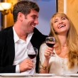 Couple is sitting at restaurant — Stock Photo