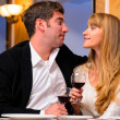 Couple is sitting at restaurant — Stock Photo #25202289