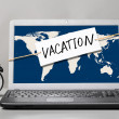 Laptop with vacation note — Stock Photo