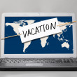 Laptop with vacation note - Stock Photo