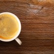 Cup of fresh espresso on table — Stock Photo