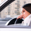 Woman is resting in a car — Stock Photo #27822385