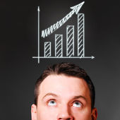 Male head with rising bar chart — Stock Photo