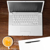Laptop and cup of coffee — Foto Stock