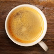 Cup of fresh espresso on table — Stock Photo #27834859