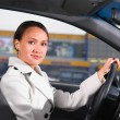 Business woman in a car — Stock Photo