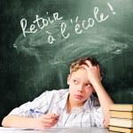Постер, плакат: Sad school boy