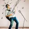 Playing on drawn guitar — Stock Photo