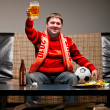 Soccer fan on sofa — Stock Photo