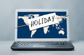 Laptop with holiday note — Stock Photo