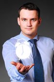 Businessman is holding alarm clock — Stock Photo