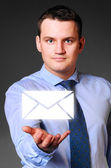 Businessman is holding message — Stock Photo