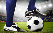 Legs of a soccer player — Stock Photo