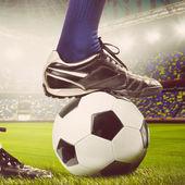 Pernas de um jogador de futebol — Fotografia Stock