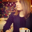 Foto Stock: Woman in cafe