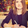 Young woman with notebook — Stockfoto #43408223