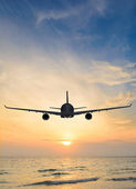 Sunset airplane — Stockfoto