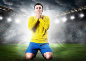 Sad soccer player — Stock Photo