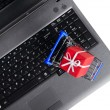 Gift on a laptop keyboard — Stock Photo #8081238