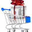 Gift box made of dollars in shopping cart — Stock Photo #8081608