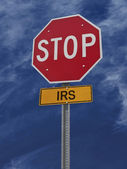 Stop irs post sign — Stock Photo
