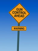 Gun control ahead warning sign — Stock Photo