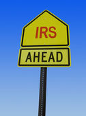 Irs ahead post sign — Stock Photo