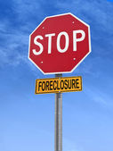 Conceptual stop sign with word foreclosure — Stock Photo