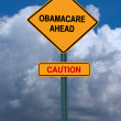 Obamacare ahead caution conceptual post — Stock Photo #32537159