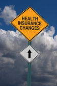 Health insurance changes ahead roadsign — Stock Photo