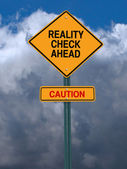Rality check ahead sign — Stock Photo