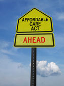 Affordable care act ahead sign — Stock Photo