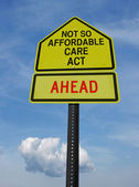 Not so affordable care act ahead sign — Stock Photo