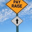 Pay raise ahead roadsign — Stock Photo