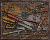 Vintage woodworking tools over rusty plate — Stock Photo