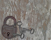 Vintage padlock on a old wooden panel — Stock Photo